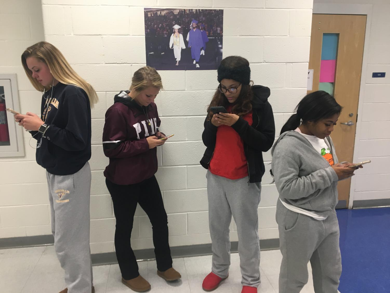 Student volunteers demonstrate technology addiction.