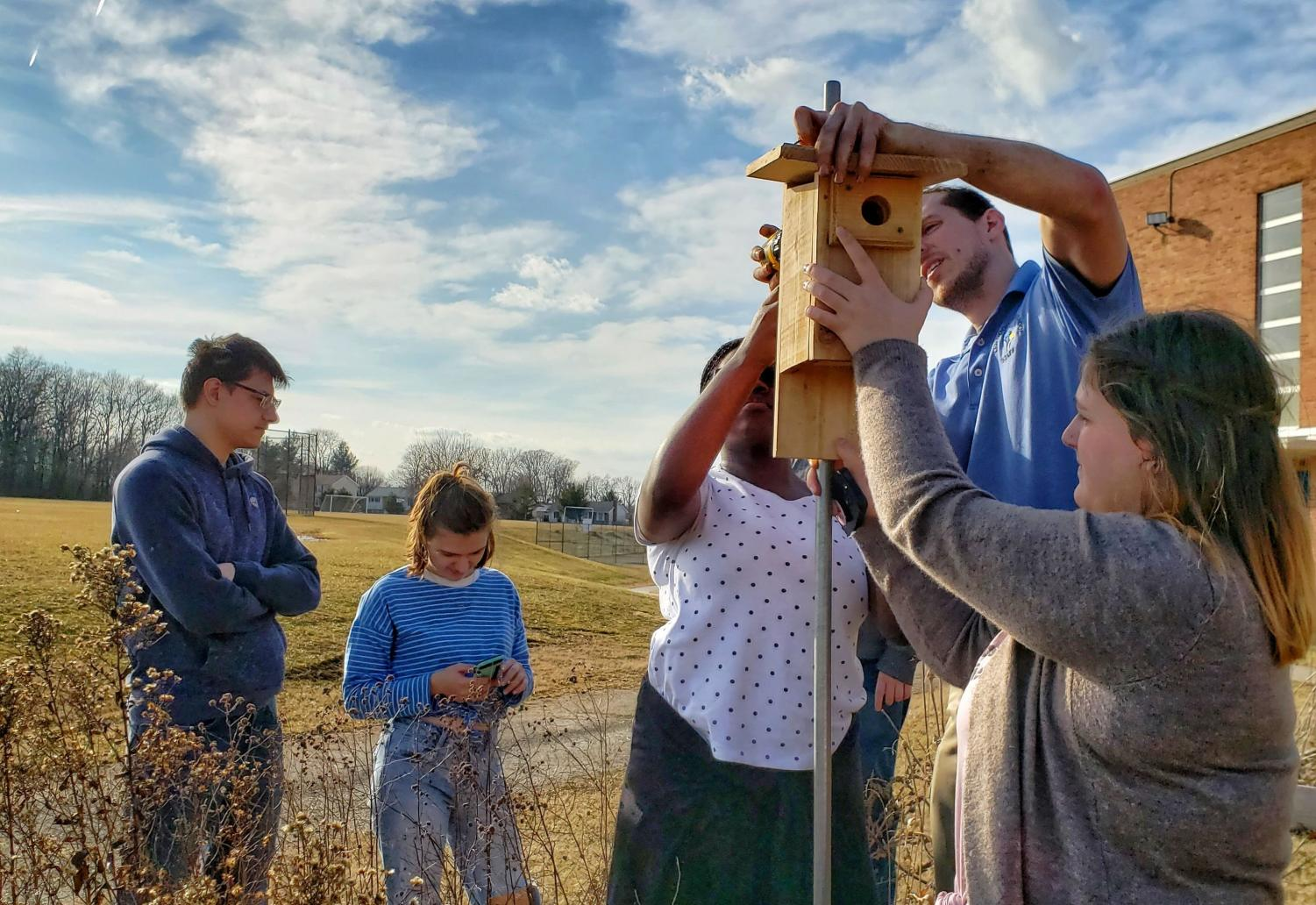 Members of K.E.N. install bluebird boxes as part of their mission to improve the environment.