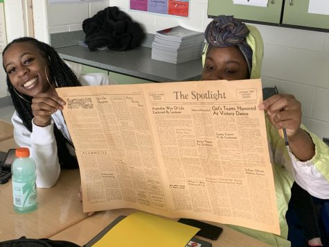 The Eye of the Bluebird staff checking out the stories in the paper sent to Ms. Magnuson.