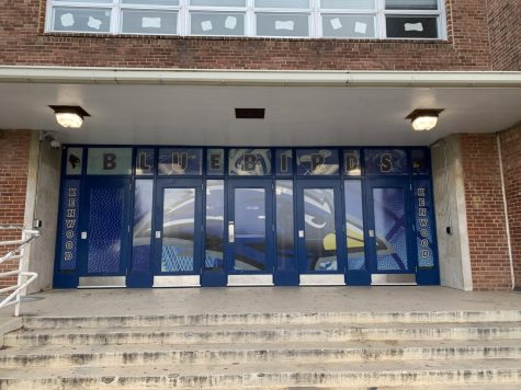 The work the 2019-2020 Graphics and Printing students did on the school gym doors.