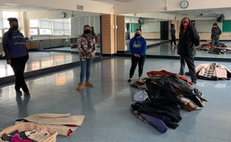 AVID 12 students collect coats for those in need.