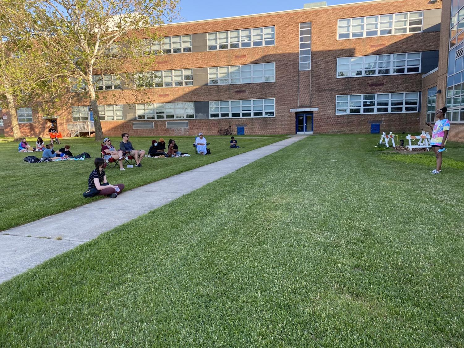 Kenwood students gather on the lawn to listen to their peers performance at Open Mic Night